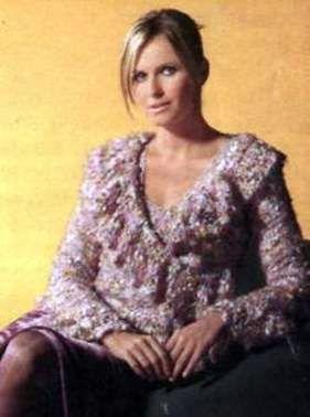 Вязаный меланжевый пуловер с рюшем размеры: 36 (38/40) 42